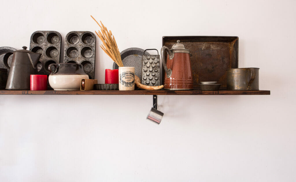 shelf in kitchen including cheese grater