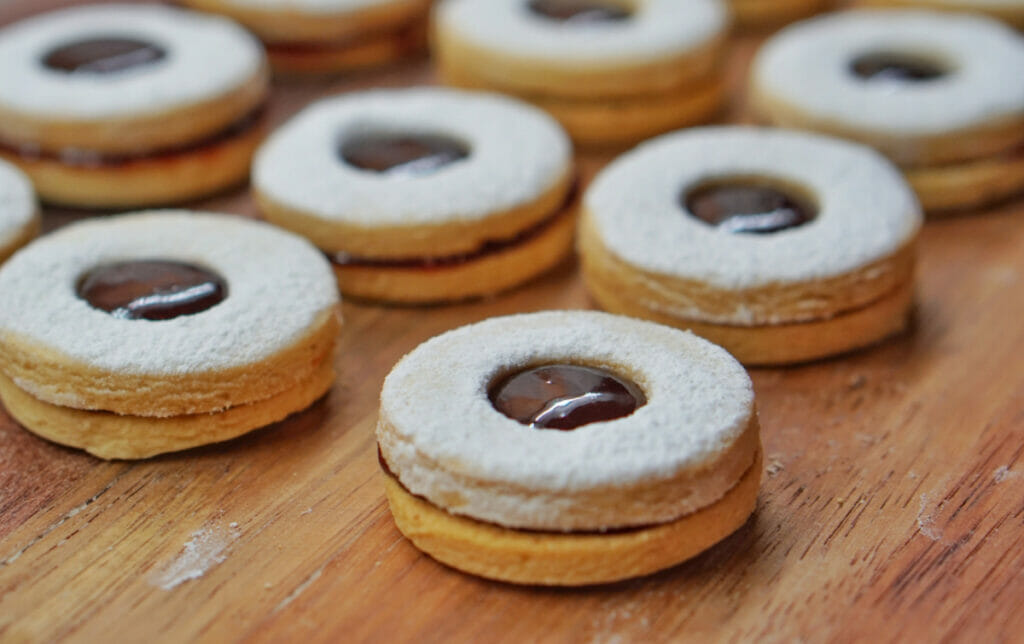 round cookie sandwiches with chocolate hole in middle