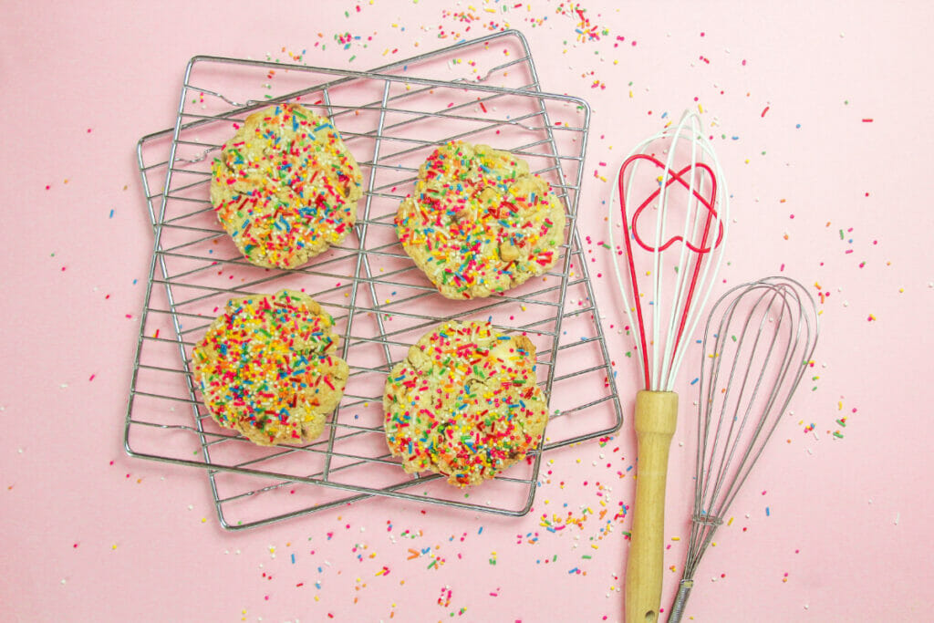 colorful cookies on a baking sheet